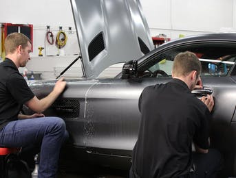 Mercedes AMG GTS being protected with Suntek matte Paint protection Film