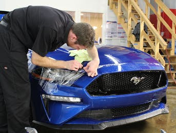 2018 Ford Mustang GT Performance Pack is being protected with from rock chips, thanks to the application of Suntek Ultra PPF